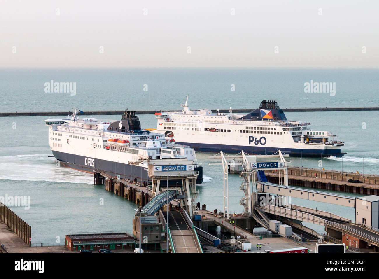 England, Dover, port. Two Car Ferries, one, DFDS docking at Dover Ferry terminal, the other, P&O, departing, - Stock Image