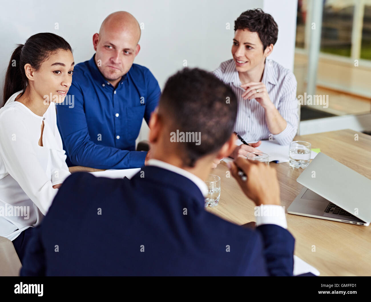 business people busy having a meeting together in board room - Stock Image