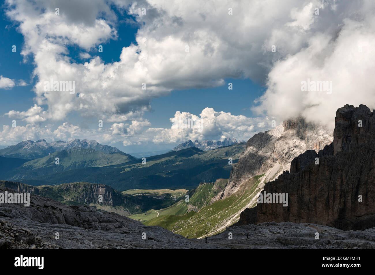 The Dolomites, Trentino, Italy. Summer view west from the plateau at La Rosetta over the hills around San Martino Stock Photo
