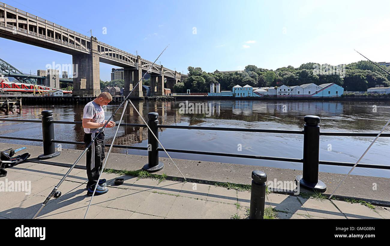 Young lad fishing on the tyne. Newcastle UK - Stock Image