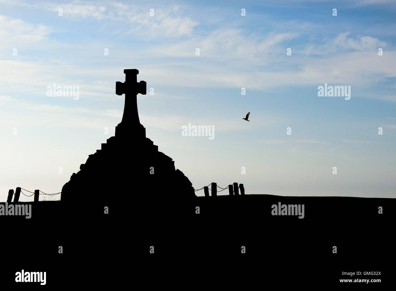The Newquay War memorial seen in silhouette. - Stock Image