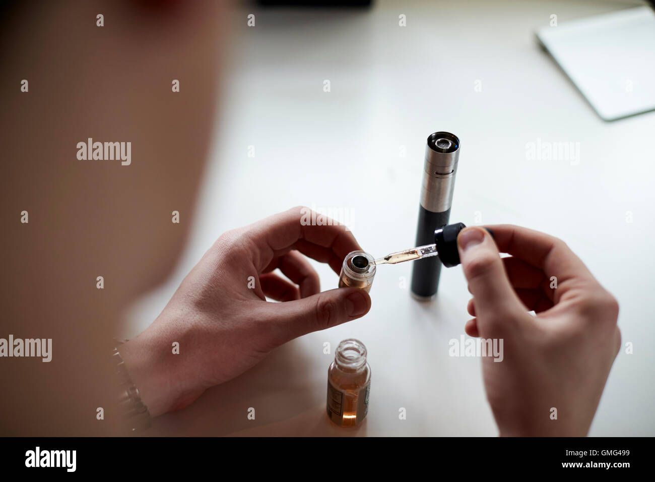 Close Up Of Man Preparing Vapourizer - Stock Image