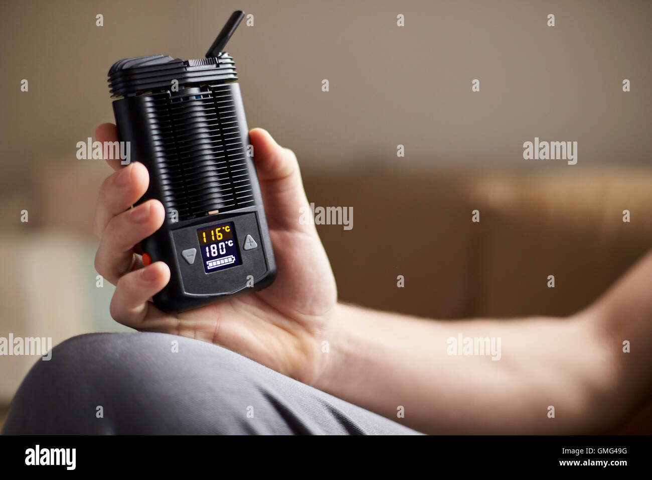 Close Up Of Man Holding Vapourizer - Stock Image