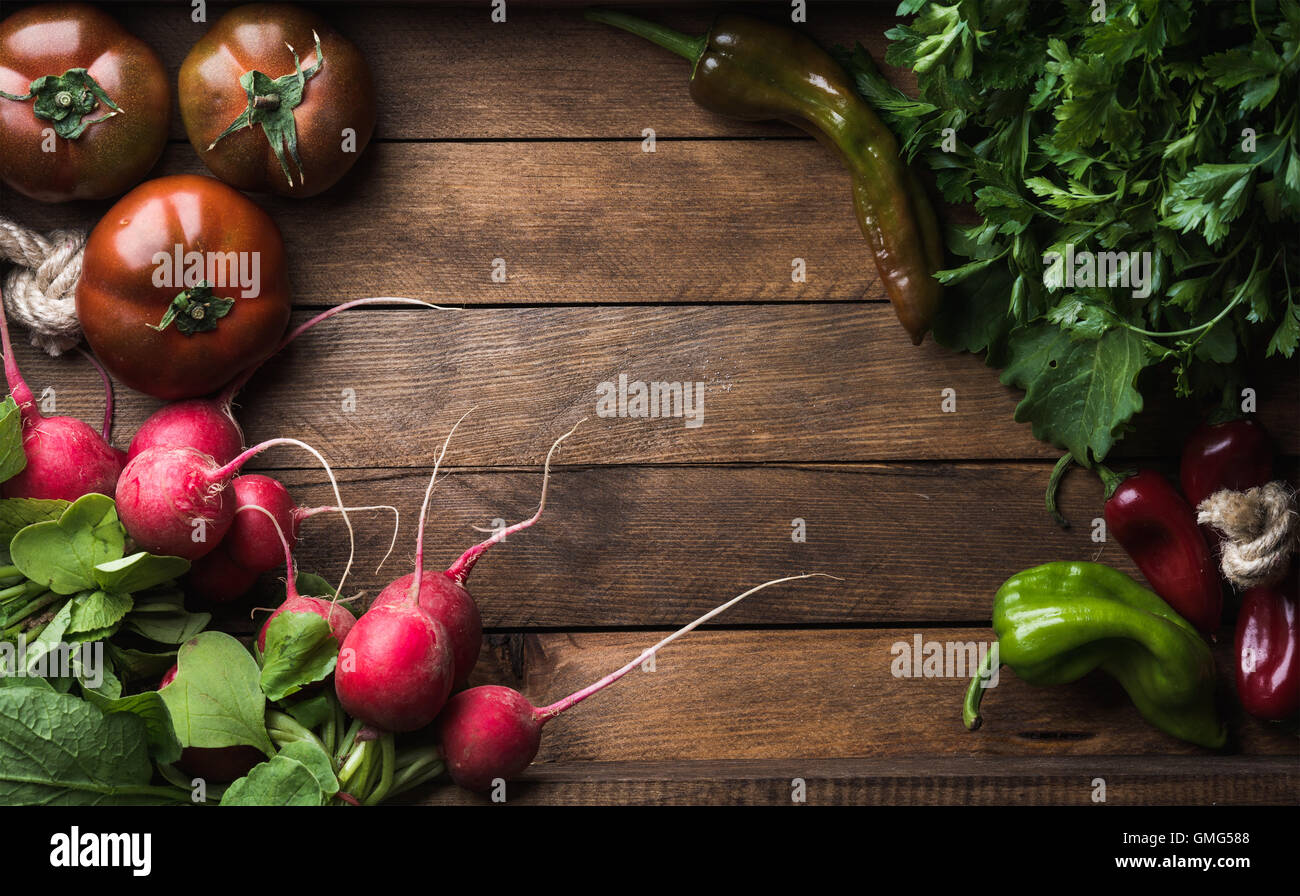 Fresh raw ingredients for healthy cooking or salad making on rustic wooden background, top view, copy space. Diet, - Stock Image