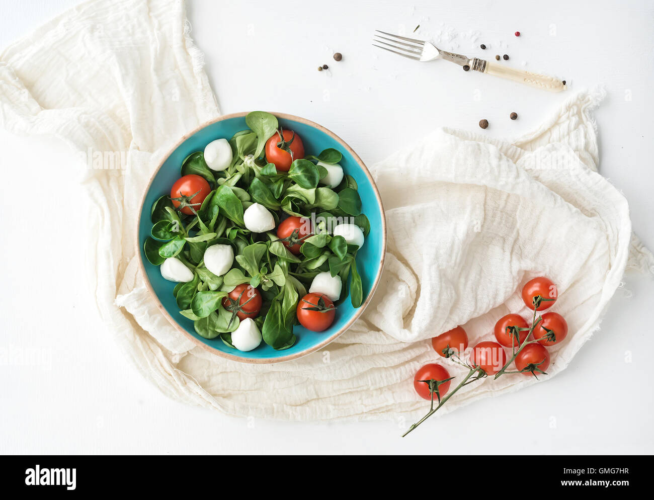 Spring salad with lamb's lettuce, mozzarella and cherry-tomatoes - Stock Image