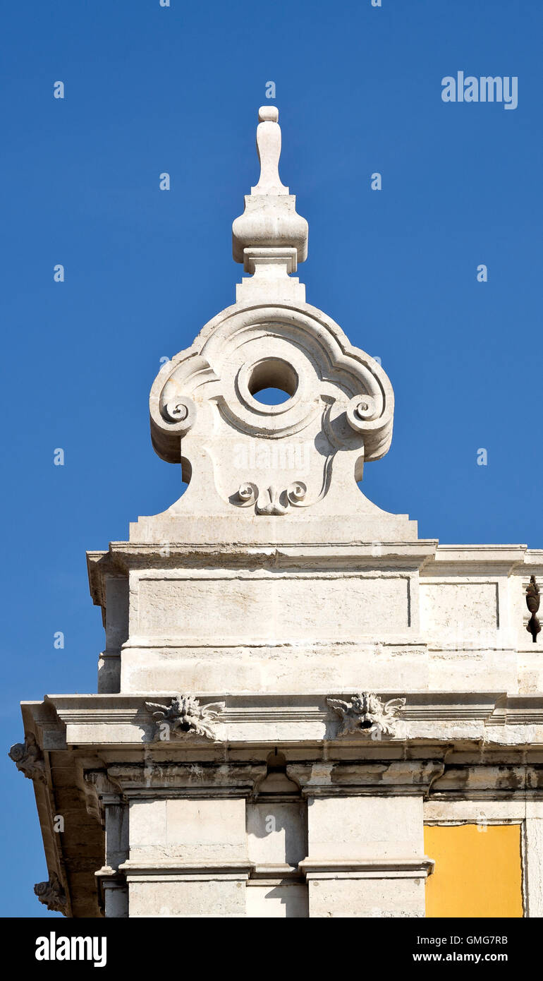 Detail of the corner decorations of the classical buildings on three sides of the Commerce Square in Lisbon, Portugal - Stock Image