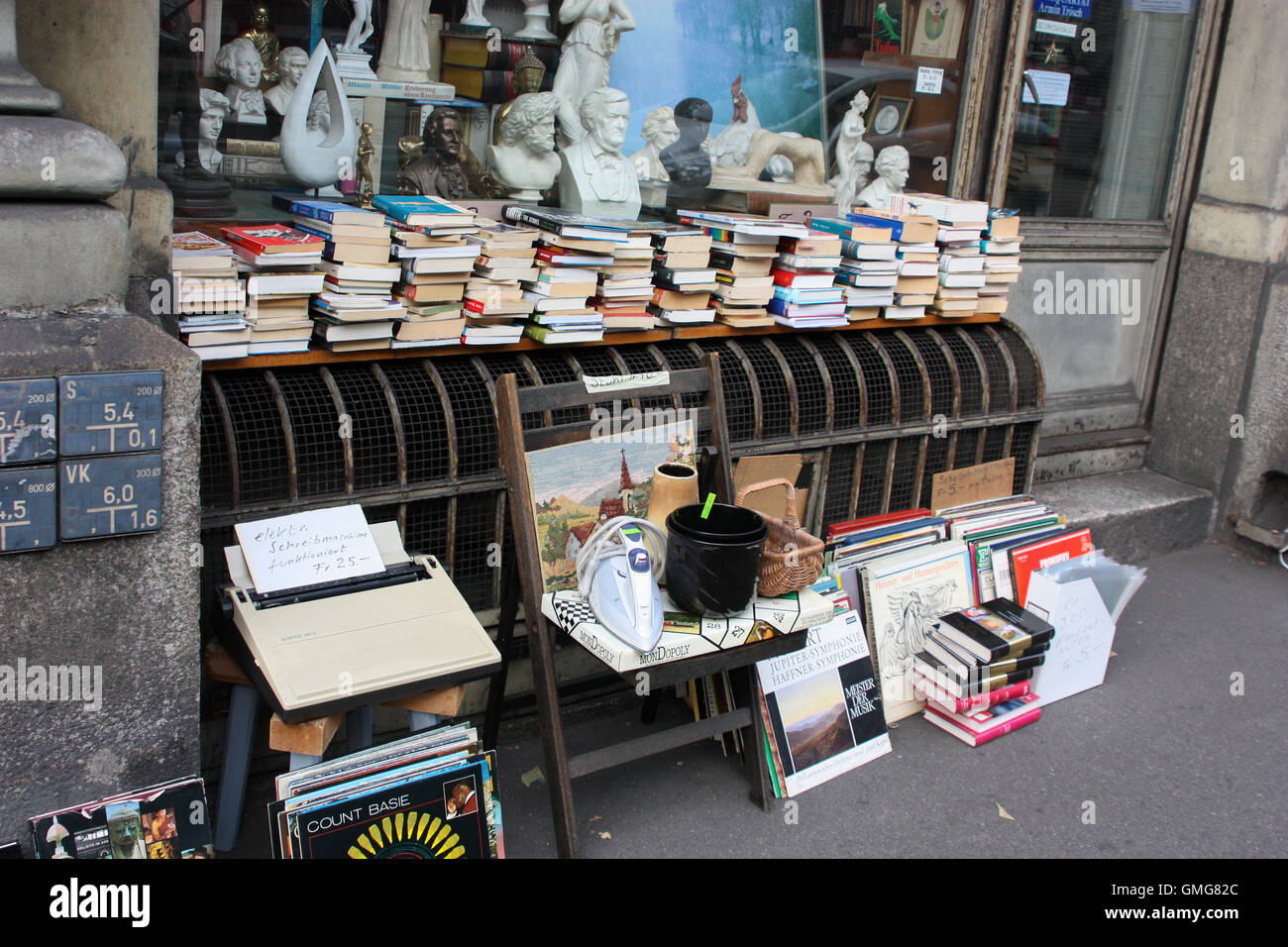 Selling books at a flea market - Stock Image