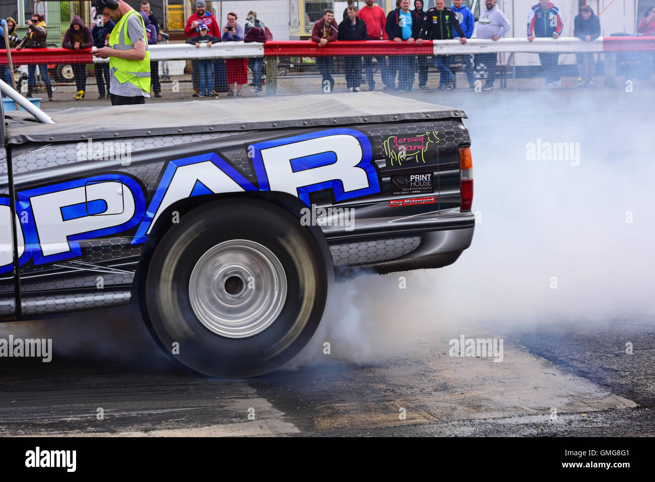 drag racing car wheel spinning to generate heat in tyres to increase grip, york drag raceway track yorkshire united Stock Photo