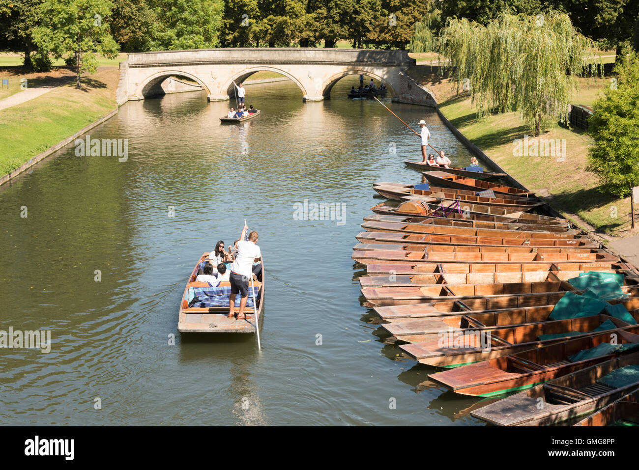 People punting on the River Cam on the Backs at Cambridge Uk in summer Stock Photo