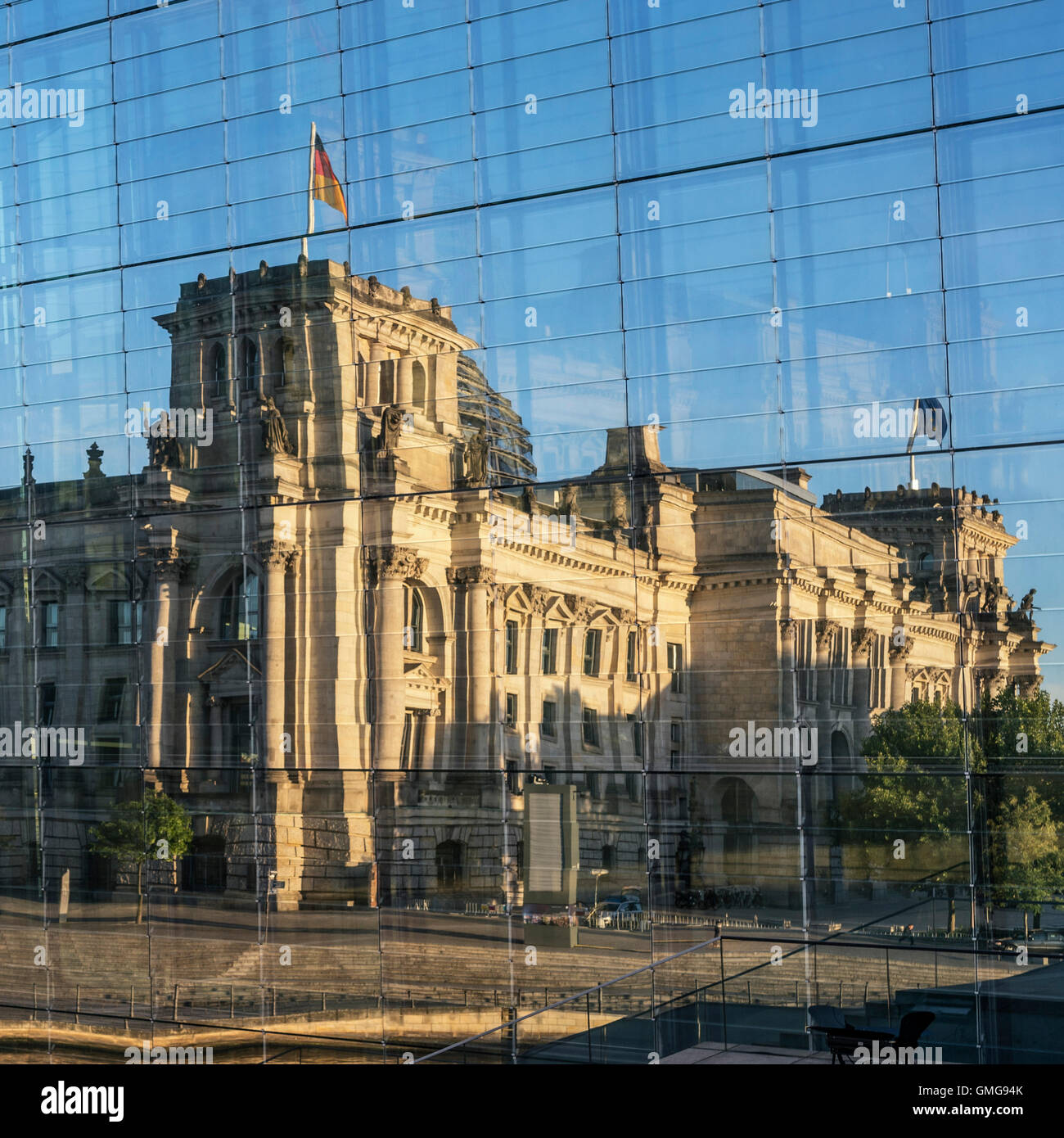 Reichstag and government buildings around river Spree in Berlin , reflection in Marie-Elisabeth-Lueders-Haus Stock Photo
