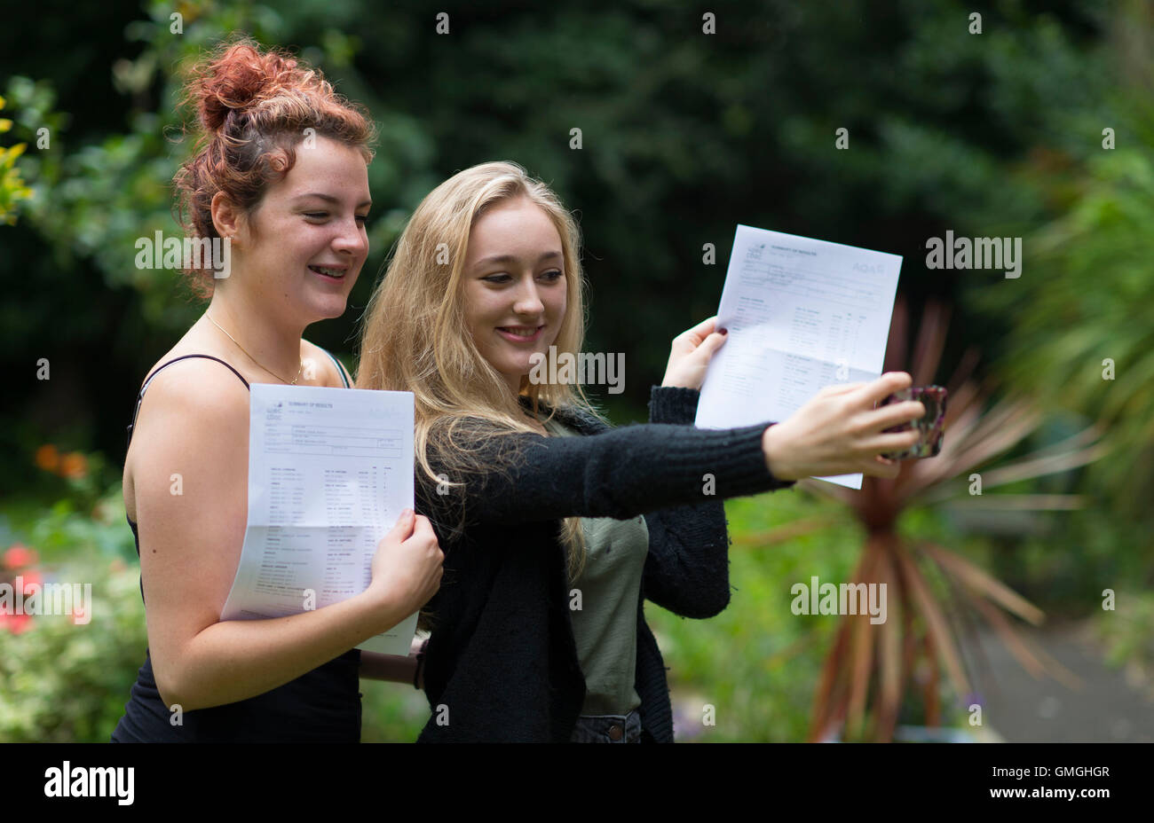 Female students collect their GCSE results at a school. - Stock Image