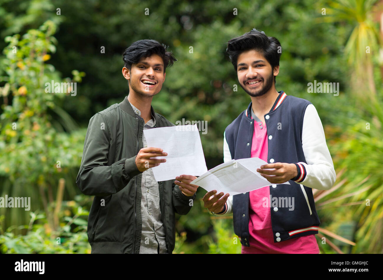 Male students collect their GCSE results at a school. - Stock Image