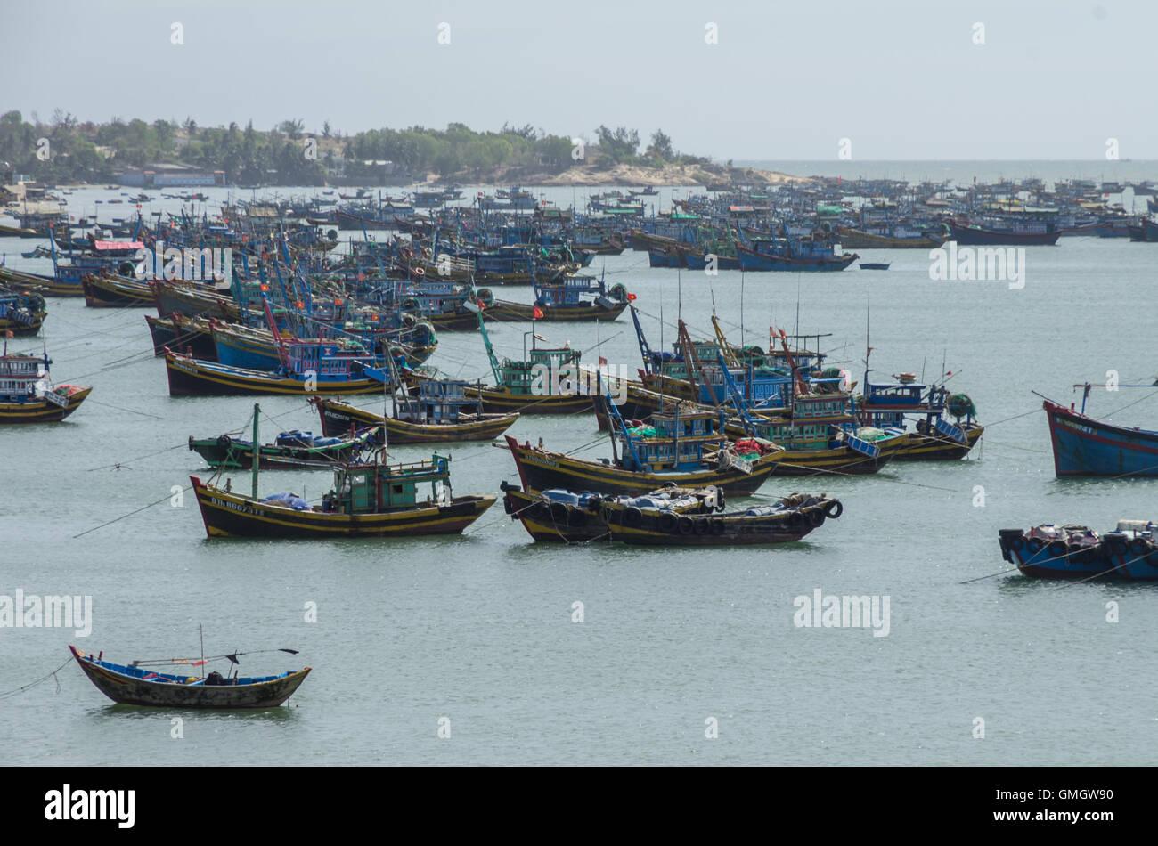 Mui Ne,Vietnam - January 15,2015: Fishing village and colorful fishing boats near Mui Ne at a sunny day. Vietnam - Stock Image