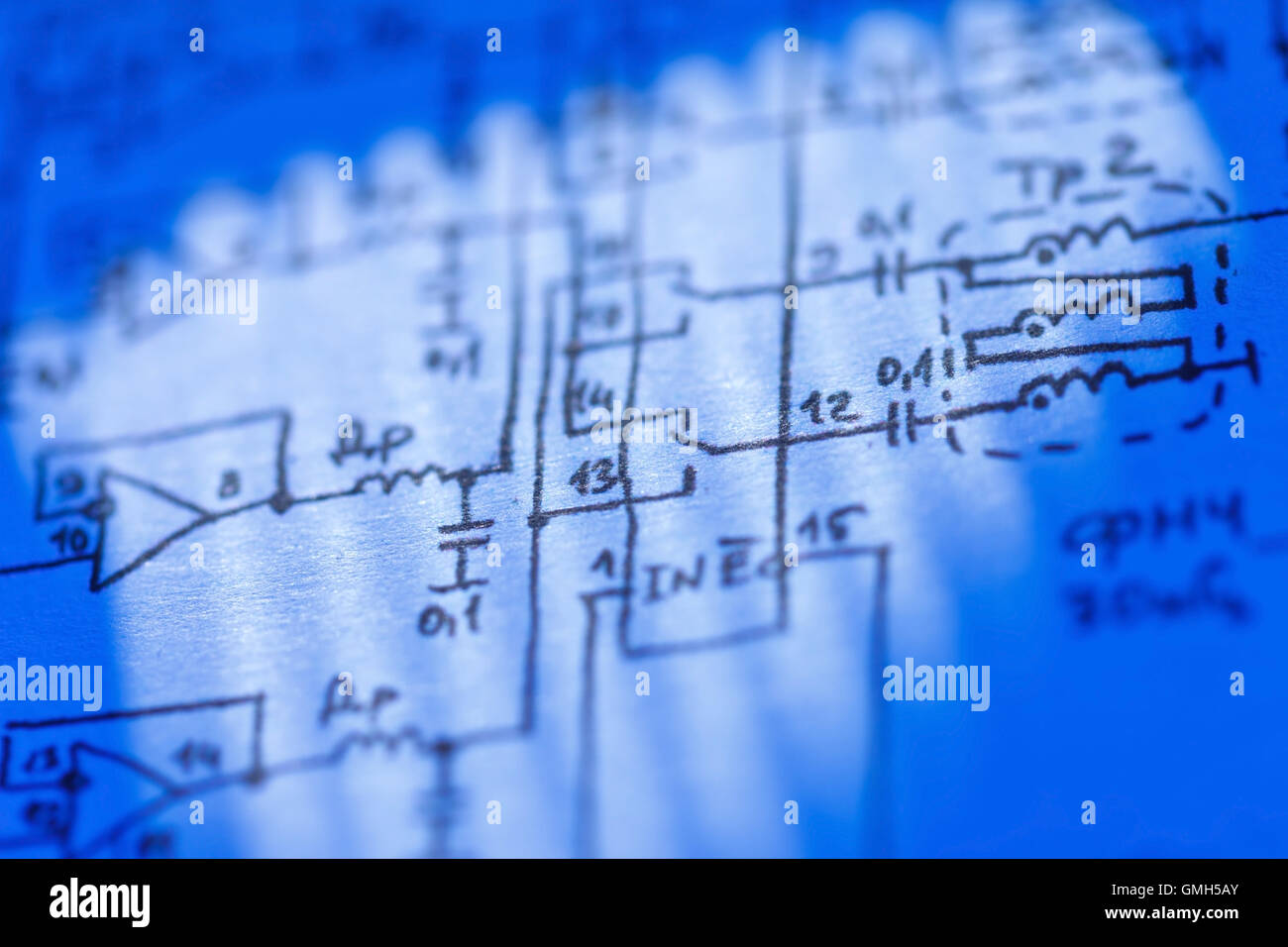 Electronics Schematic Stock Photos Glass On The Electronic Diagramideal Technology Background Image