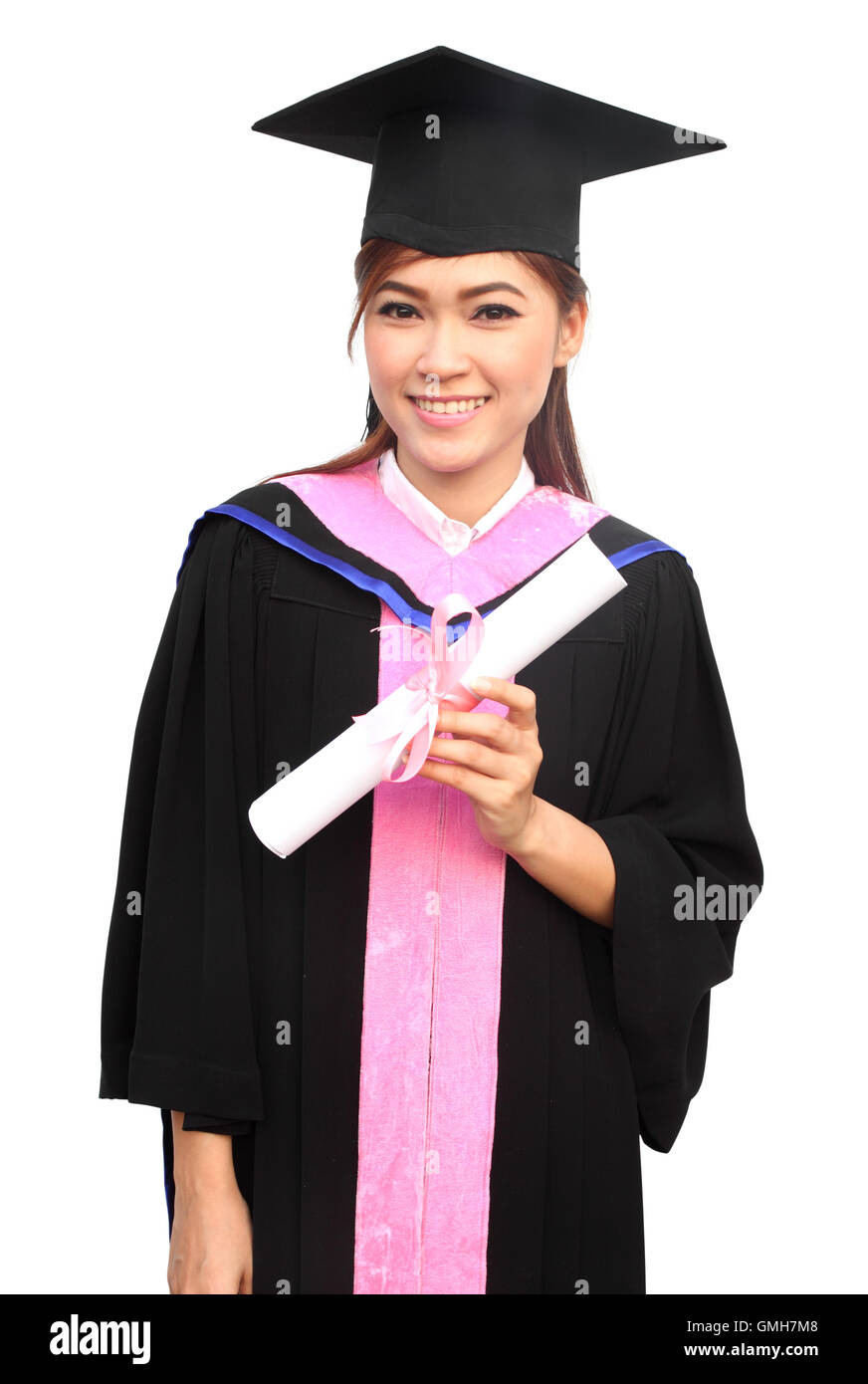 20e6c969ea7 woman with graduation cap and gown with arm raised holding diplo ...