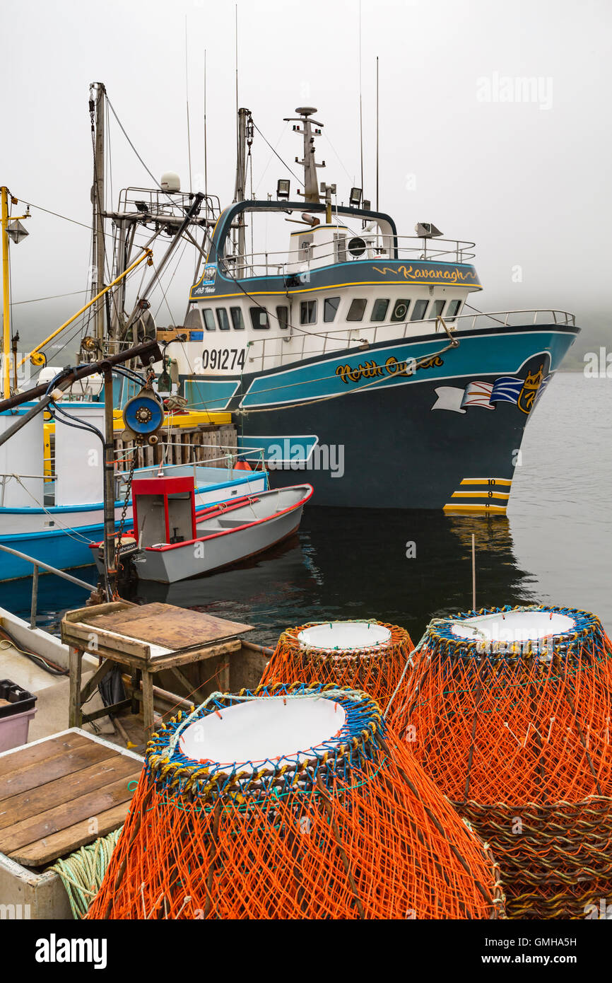 Fishing gear and boats at Cape Broyle, Newfoundland and Labrador, Canada. - Stock Image