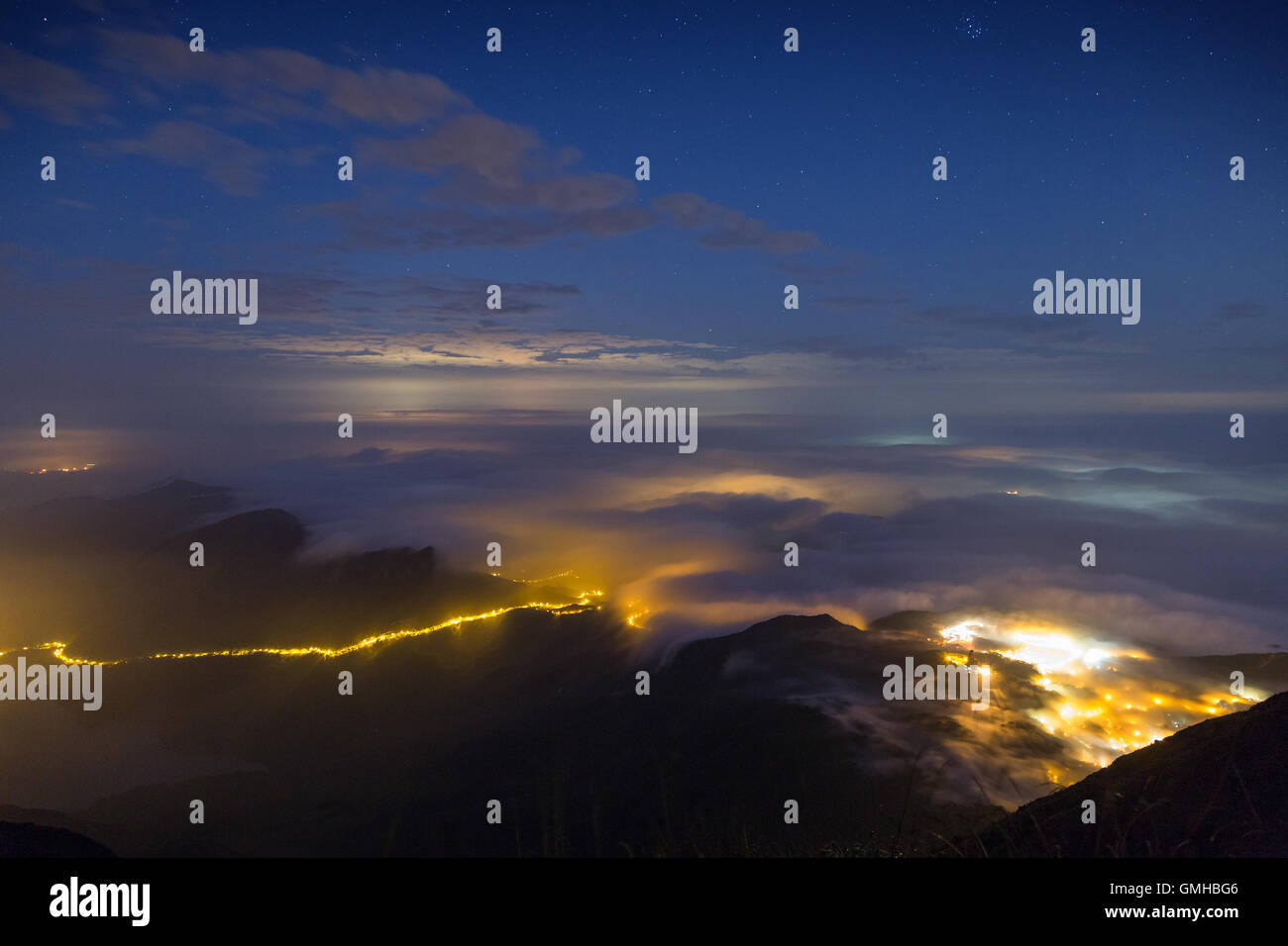 Scenic view from the Lantau Peak (the second highest peak in Hong Kong, China (934m)) at night. Copy space. - Stock Image