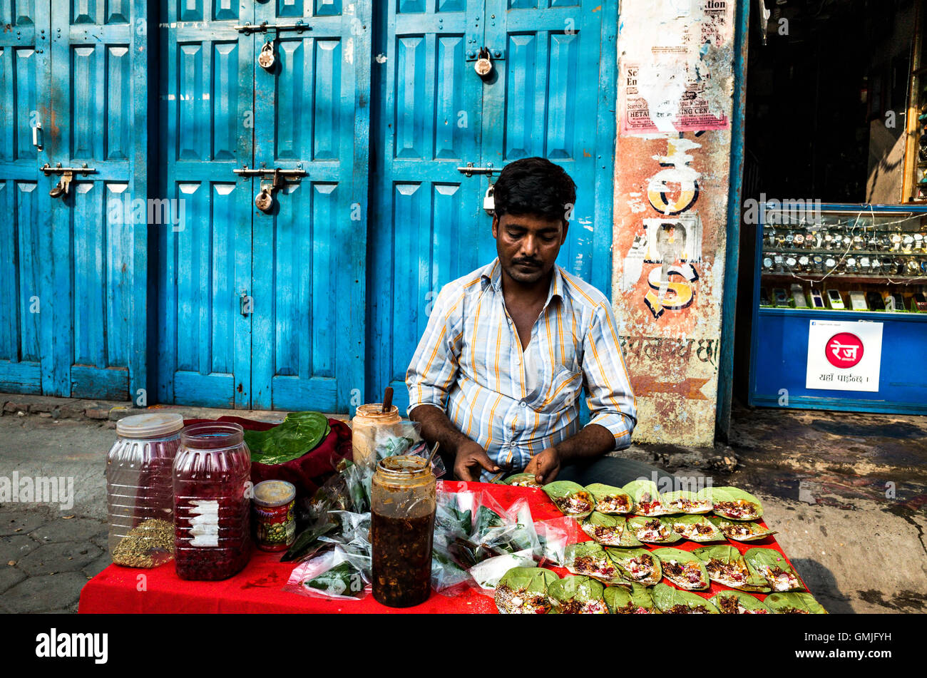 travel portrait of an Indian middle-aged man of 30-40 years old selling Paan in the street - Stock Image