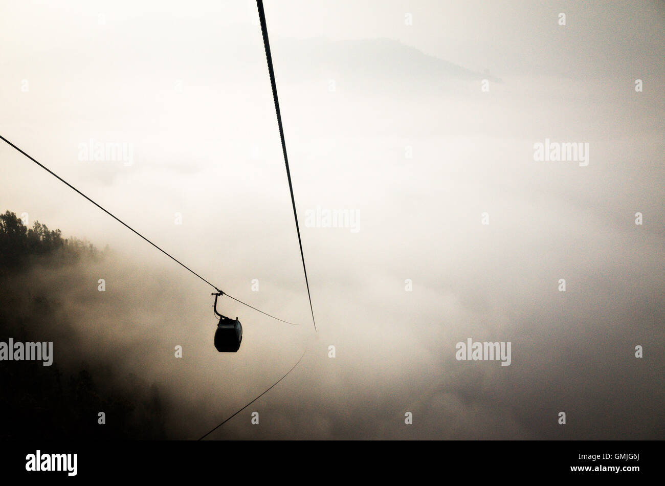 a cable car in a foggy cloudy day - Stock Image