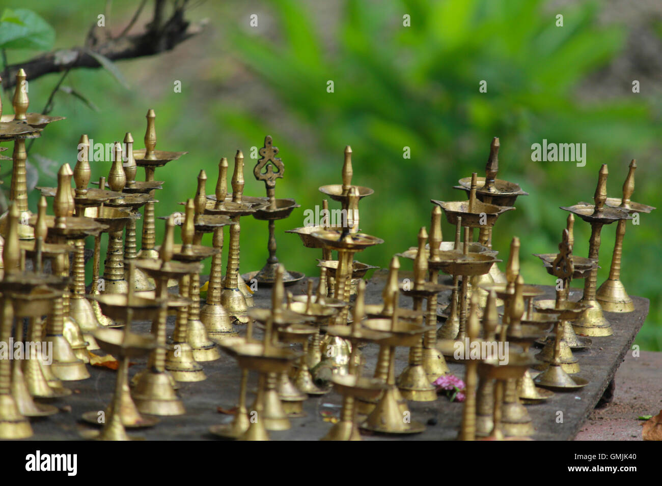 Group Of Brass Temple Lamps (Indian Oil Lamp) In Green Background.