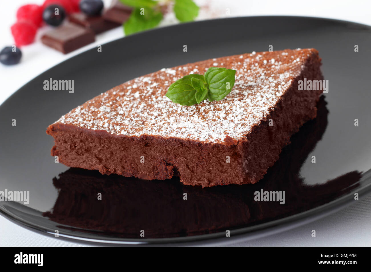 chocolate cake with soft chocolate core and fruits. - Stock Image