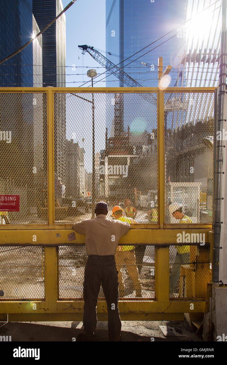 New York City, NY, USA - November 24, 2014. Man observing workers in the 9/11 memorial area. Stock Photo
