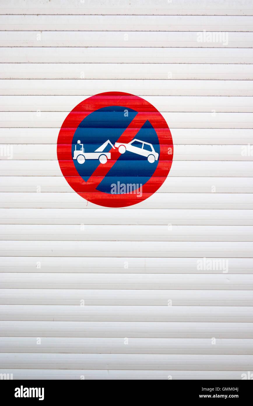 No parking sign on garage door in France - Stock Image