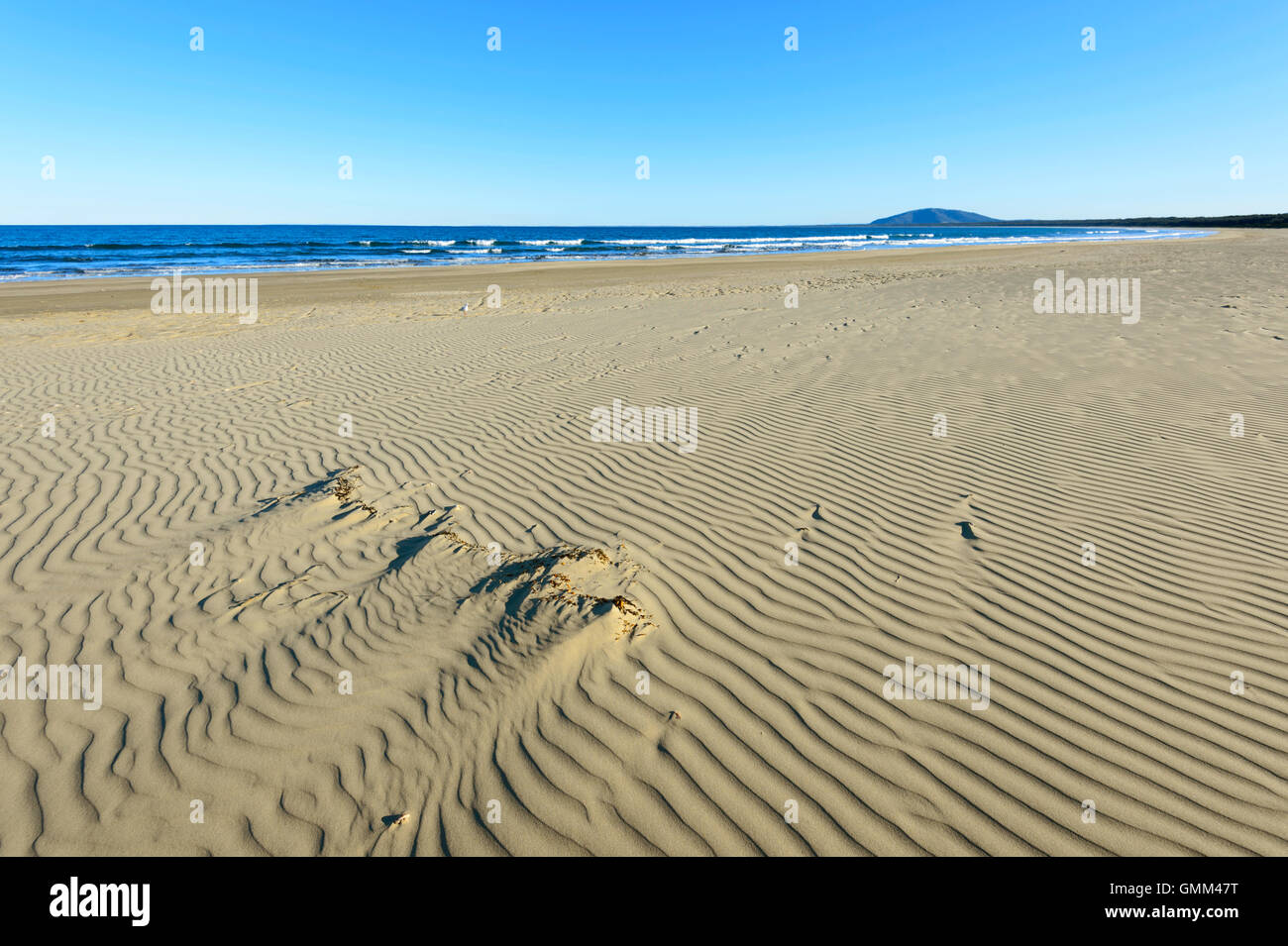 The sandy and deserted beach of Seven Mile Beach at Gerroa, Illawarra Coast, New South Wales, NSW, Australia - Stock Image