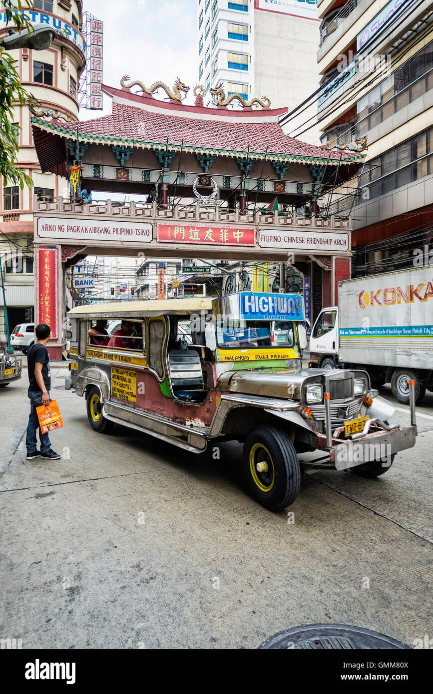 jeepney and busy street urban traffic in central manila city chinatown philippines - Stock Image