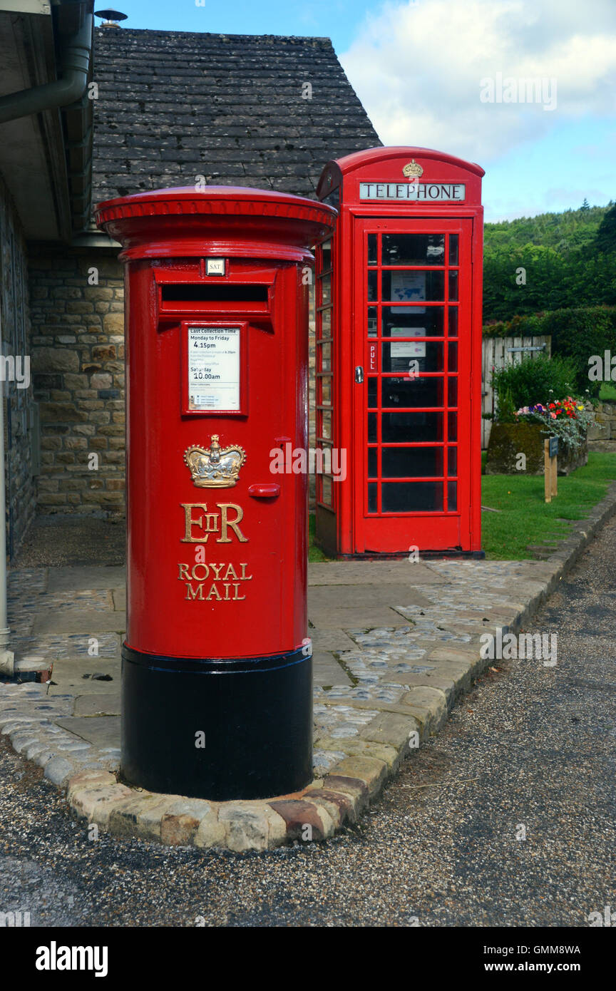 Traditional British Red Post Box & Telephone Kiosk in the Village of Bolton Abbey, Wharfedale Yorkshire,UK - Stock Image