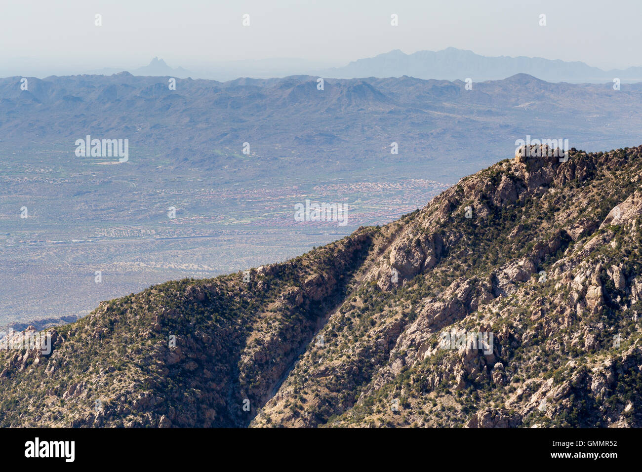 Urban sprawl from Tuscon spreading out below the Santa Catalina Mountains. Pusch Ridge Wilderness, Arizona - Stock Image