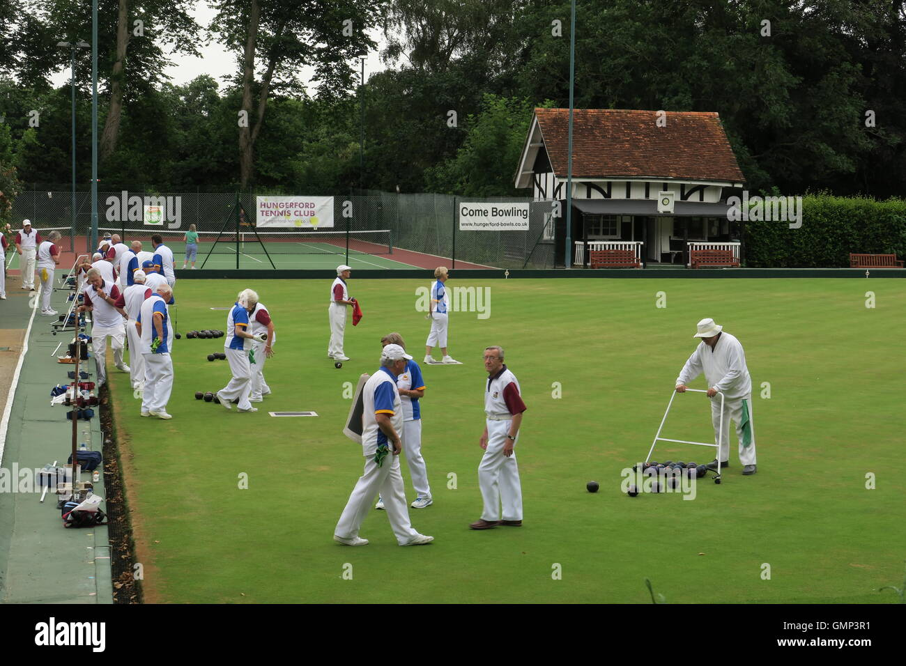A bowling match at Hungerford Bowling Club. Lawn bowls uses a flat lawn unlike the slightly domed lawn of Crown - Stock Image