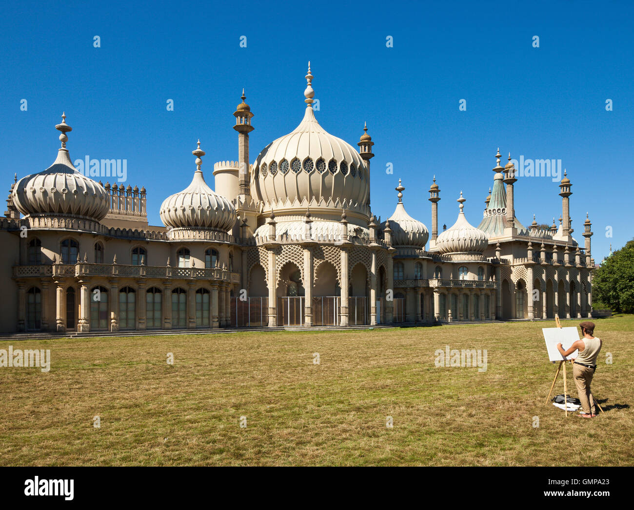 Brighton Pavilion and artist. - Stock Image