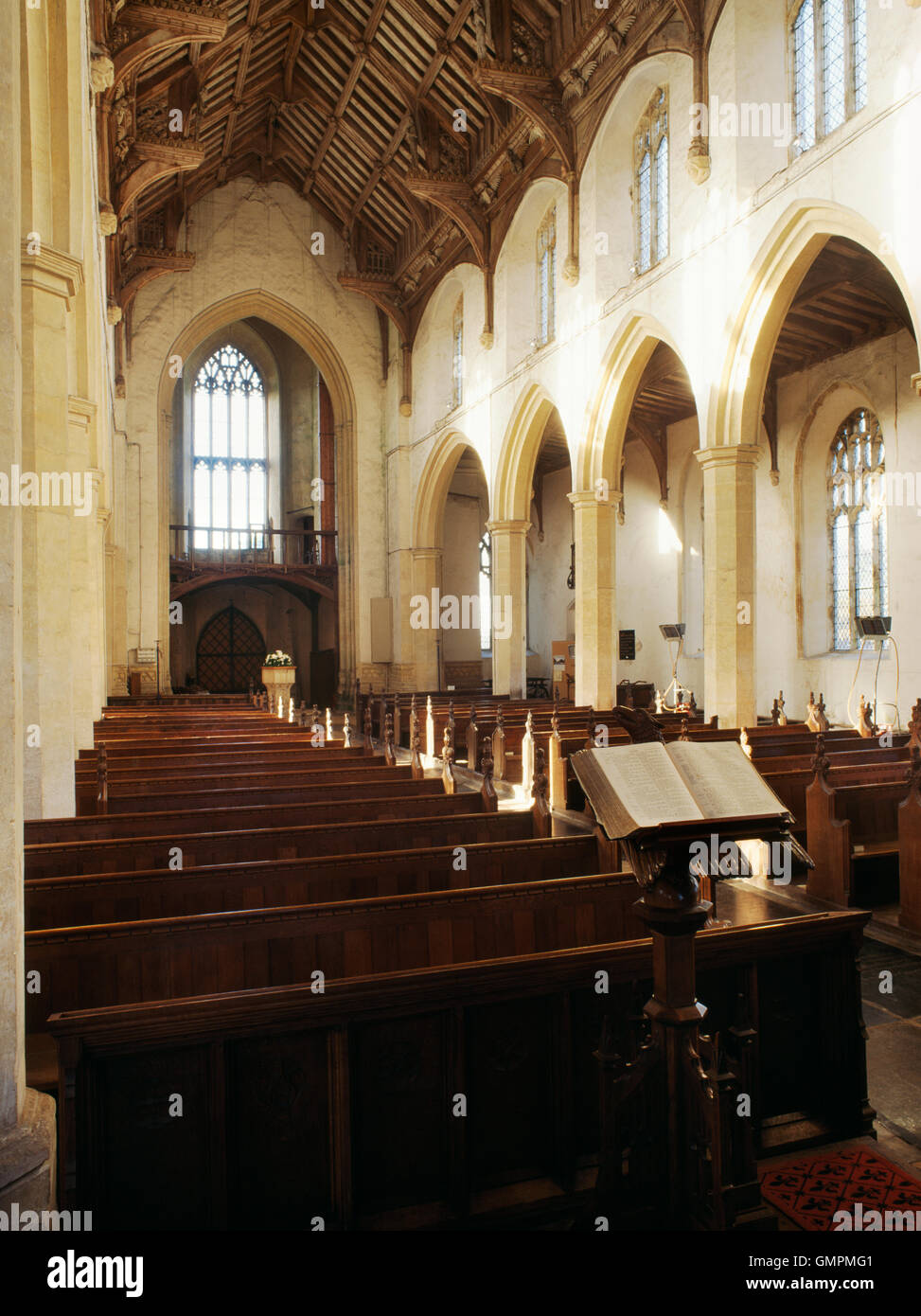 Nave & N aisle of St Agnus' Church, Cawston, looking WNW towards plough gallery in the tower. C15th hammer - Stock Image