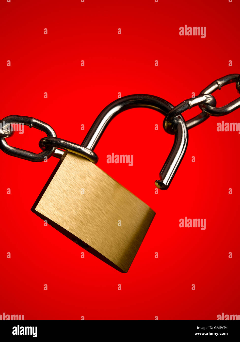 Padlock and chain on red - Stock Image