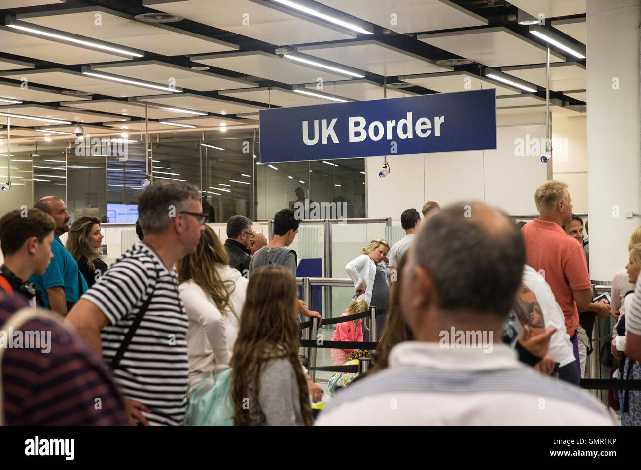 People queuing at the UK border immigration control at Gatwick South Terminal Stock Photo
