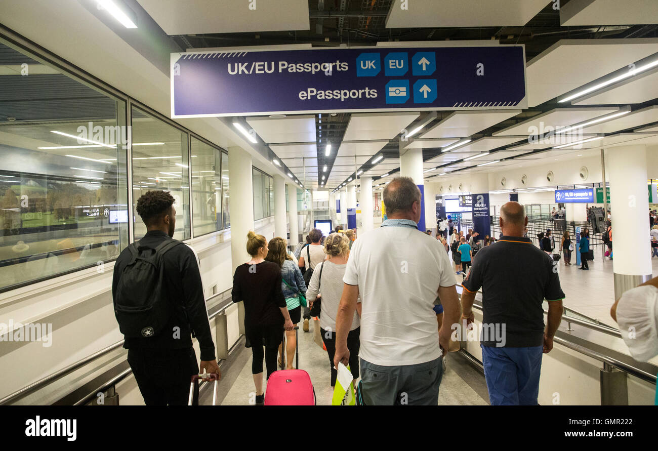 People arriving at the UK border immigration control at Gatwick South Terminal Stock Photo