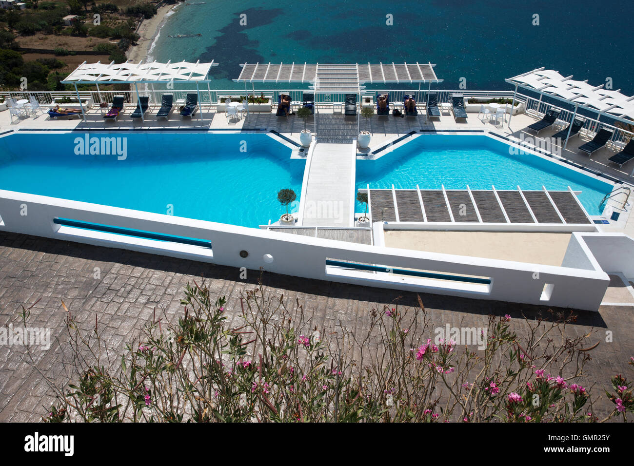 An empty swimming pool at a hotel in Greece showing the downturn in the tourist business - Stock Image
