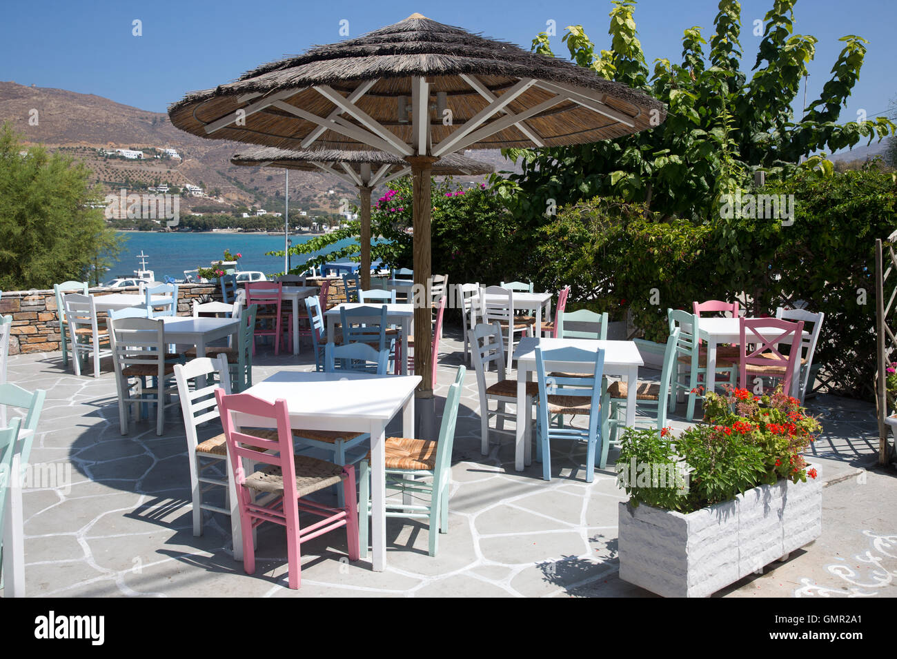 An empty Greek taverna in mid summer.Many British tourists have decided to take a holiday in the UK - Stock Image
