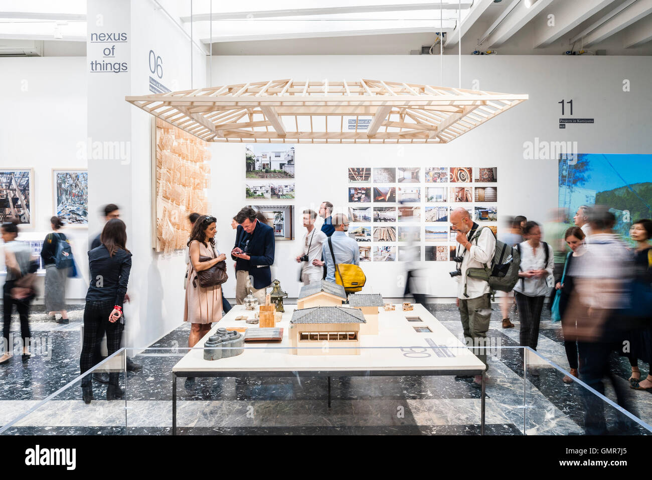 Visitors looking at models and the exhibition room. Japan Pavilllion at the XV Venice Biennale, Venice, Italy. Architect: - Stock Image