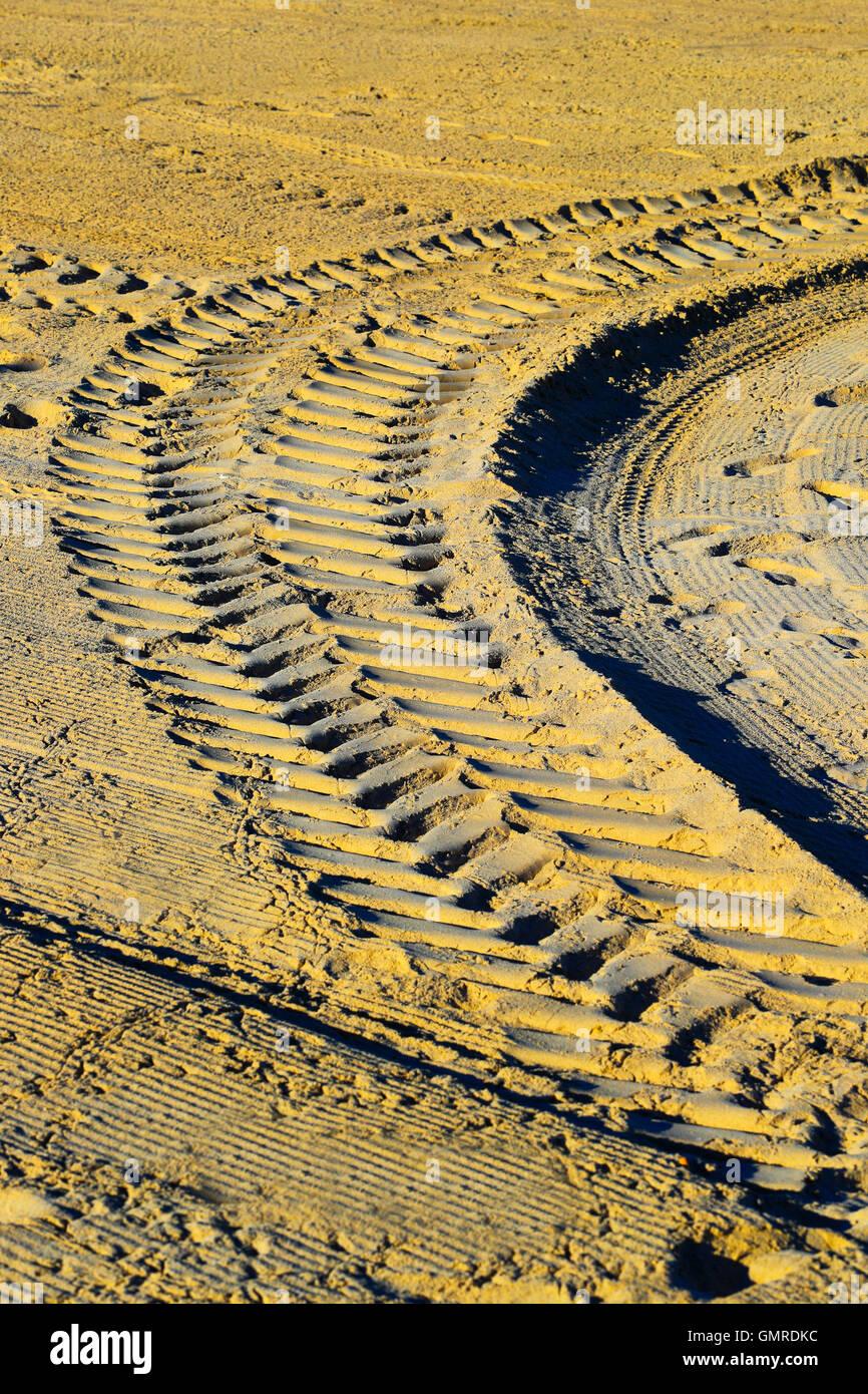 Tire tracks on the beach - Stock Image
