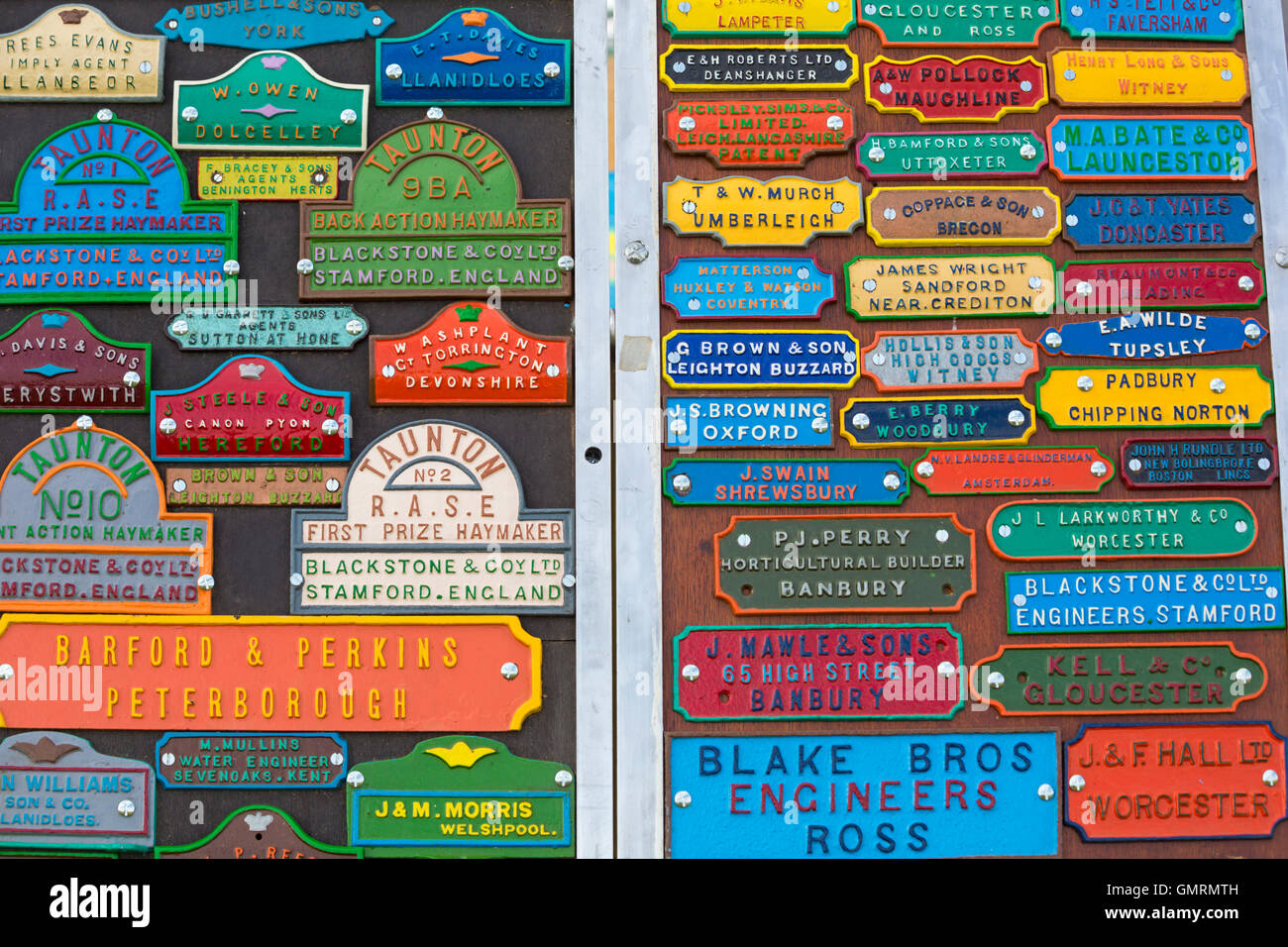 Collection of nameplates on display at  Great Dorset Steam Fair, Tarrant Hinton, Dorset in August - Stock Image