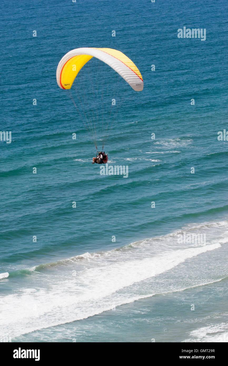 Tandem paragliding over ocean in San Diego, California Stock