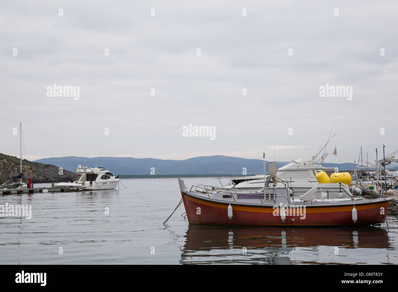 Boats moored at the port on a cloudy day Stock Photo