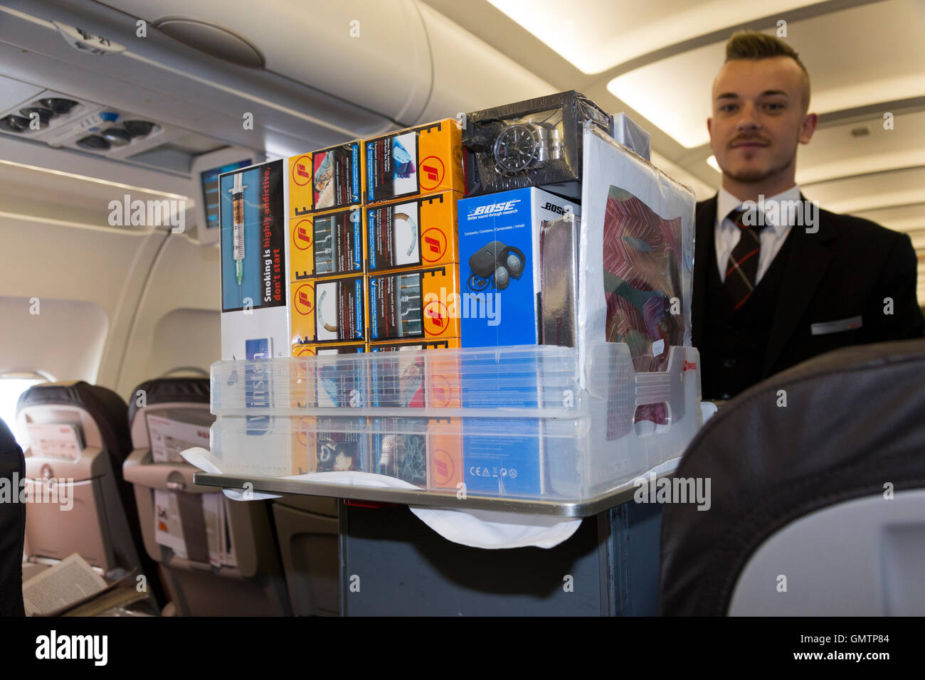 Member of cabin crew & duty free trolley on Swiss Airbus A321 airplane to sell goods to passengers on an air - Stock Image