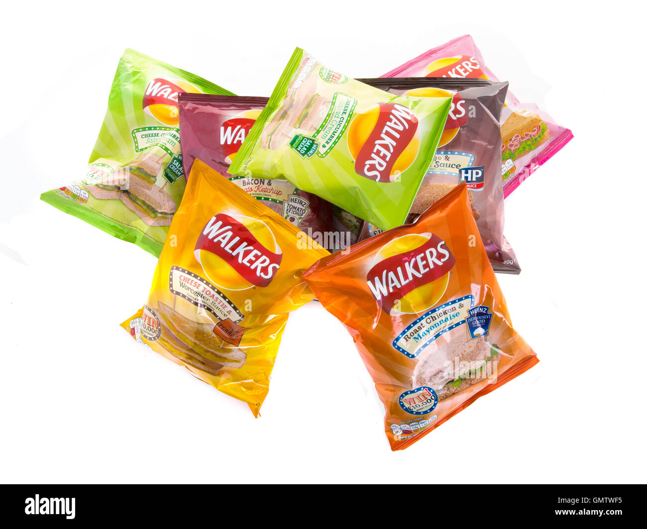 Bags of Walkers new Flavour crisps isolated on a white background. Walkers is a British snack food manufacture, - Stock Image
