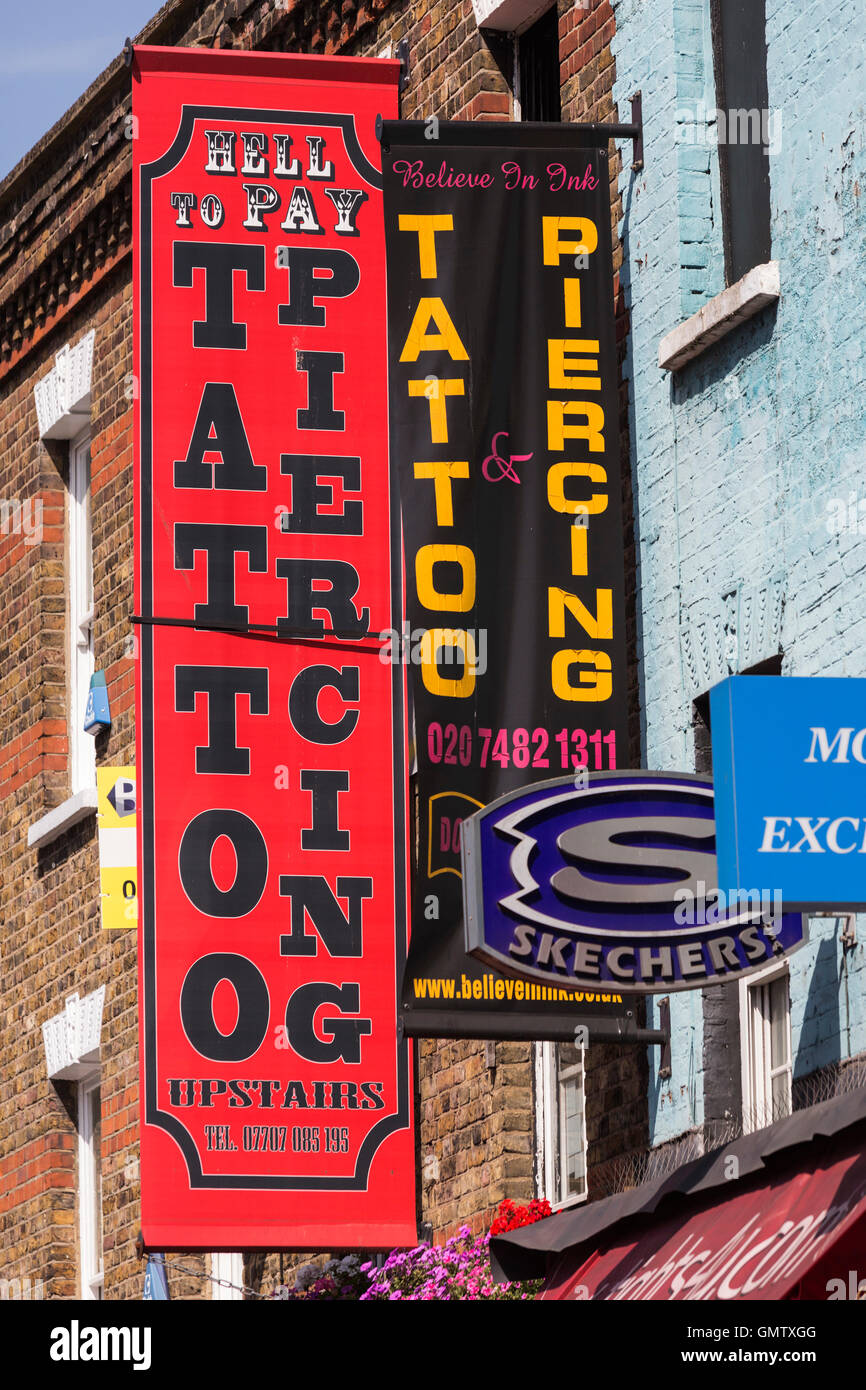 7badde0e4 Tattoo and Piercing shop, sign at Camden Lock Market, Camden, London,  England, United Kingdom