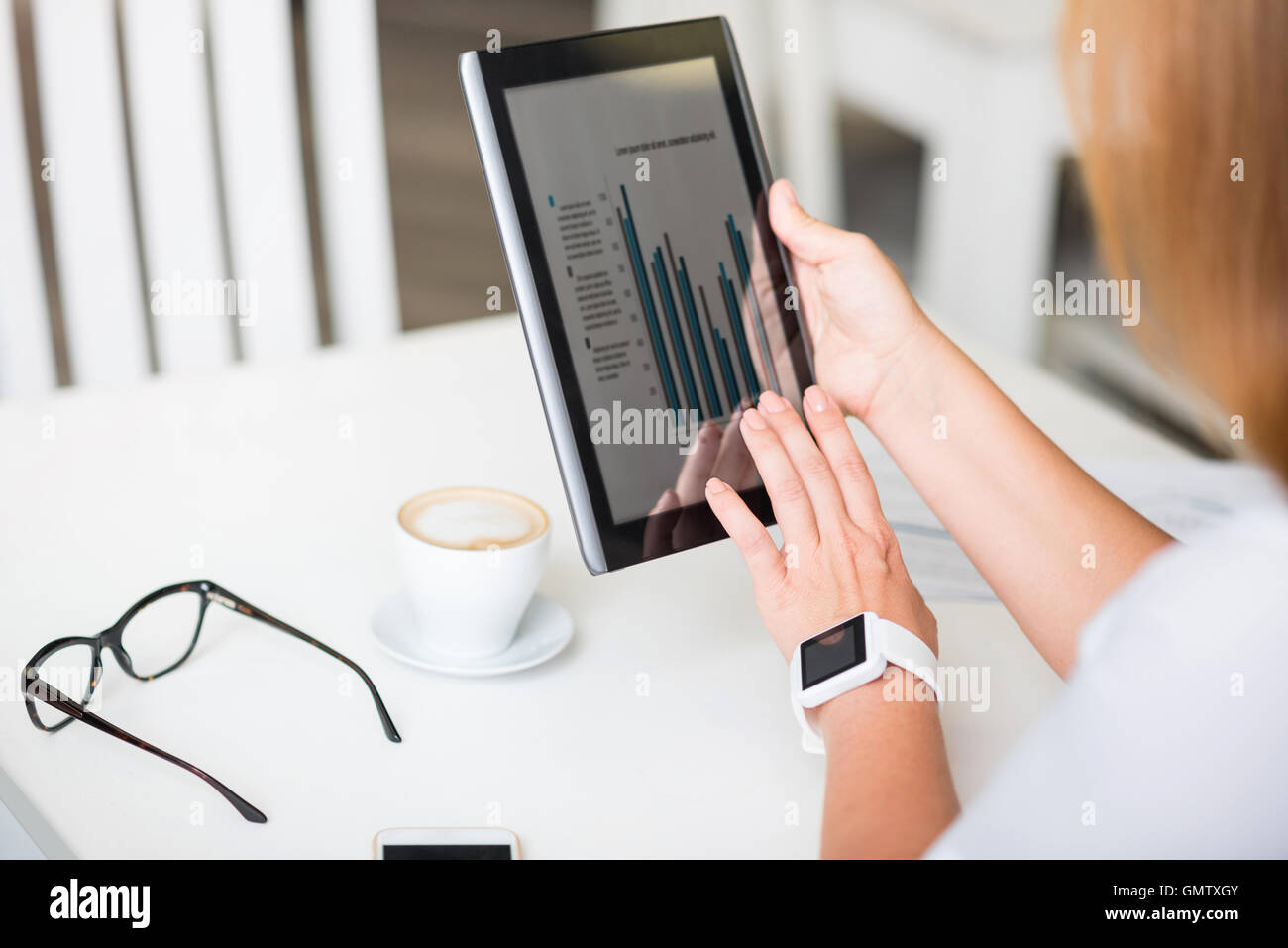 Pleasant woman using tablet - Stock Image