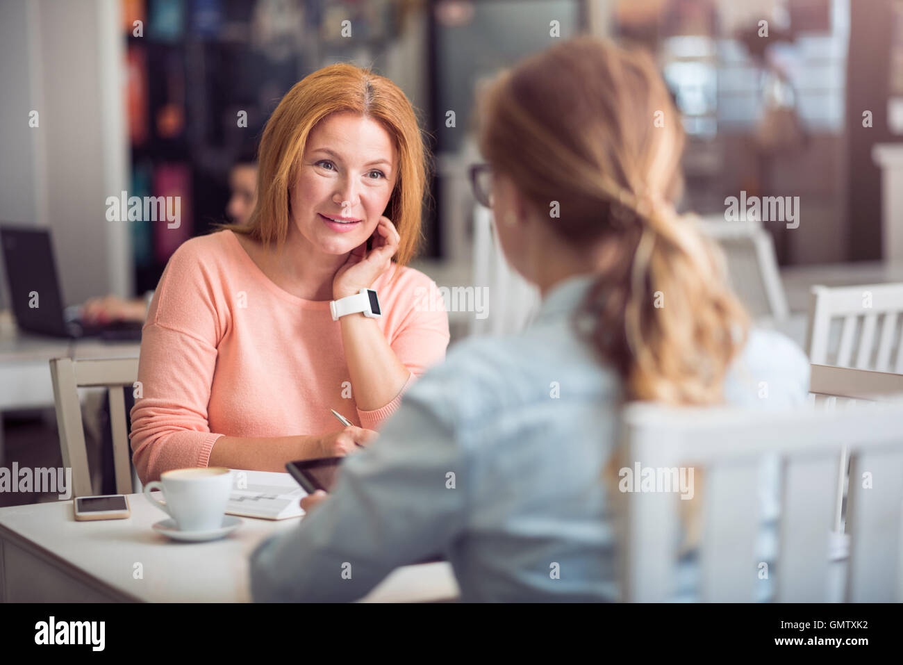 Pleasant senior woman conducting an interview - Stock Image