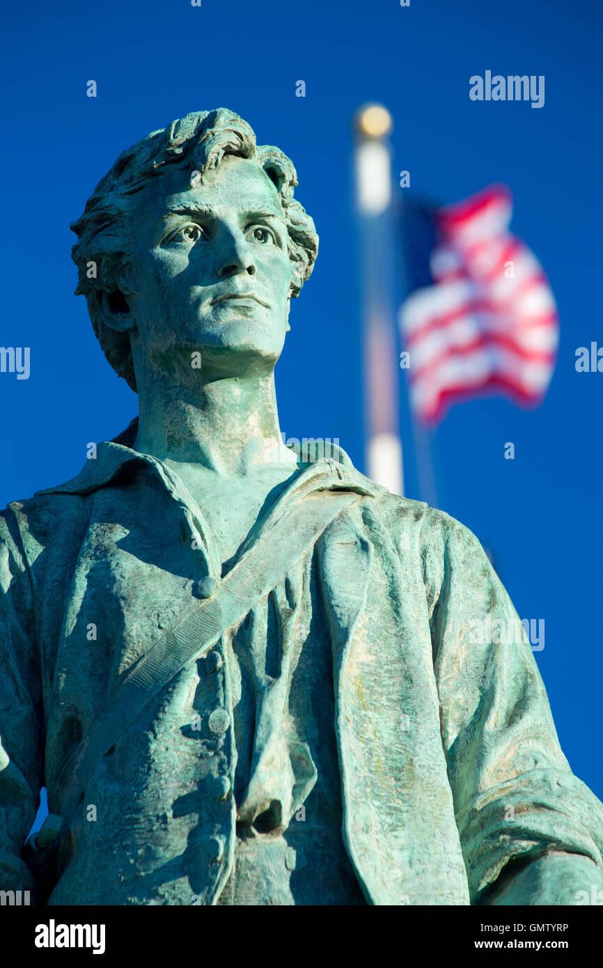 Captain Parker statue on Battle Green with American flag, Lexington Green, Lexington,  Massachusetts Stock Photo